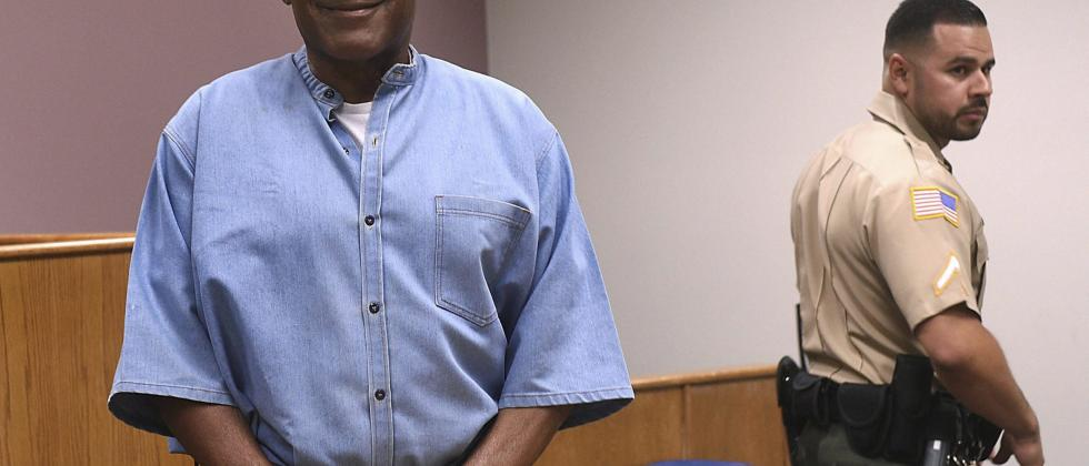 In this July 20, 2017, file photo, former NFL football star O.J. Simpson enters for his parole hearing at the Lovelock Correctional Center in Lovelock, Nev.
