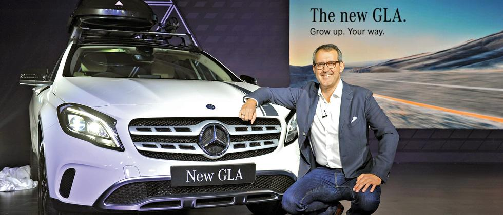 VP of Mercedes-Benz India Michael Jopp poses with the new GLA at the launch of the car in Mumbai.