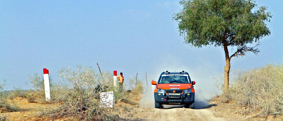A participant in Xtreme category passes a checkpoint in Jaisalmer