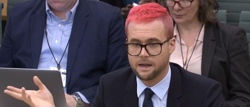 A video grab from footage broadcast by the UK Parliament's Parliamentary Recording Unit (PRU) shows data analytics expert Christopher Wylie who worked at Cambridge Analytica appears as a witness before the Digital, Culture, Media & Sport Committee.AFP/PRU