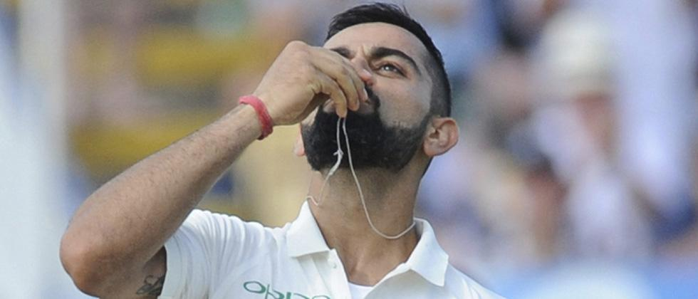 Gritty Virat Kohli stands tall amidst ruins as India score 274
