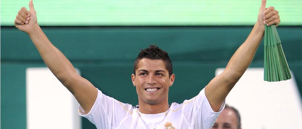 File photo taken on July 06, 2009 Real Madrid's new player Portuguese Cristiano Ronaldo waves to supporters during his official presentation at the Santiago Bernabeu stadium in Madrid. Pierre-Philippe Marcou/AFP