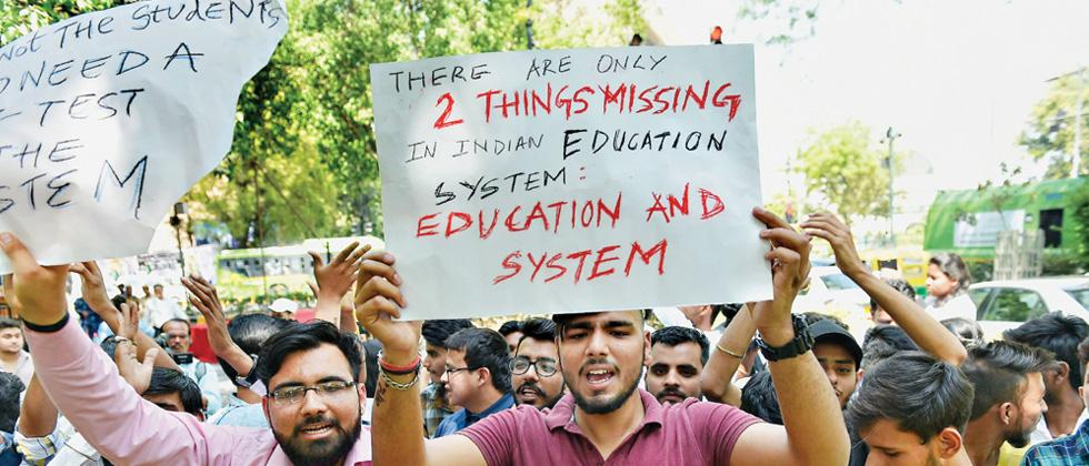 CBSE paper leaks: Students take to streets; Cong demands HRD min's sacking
