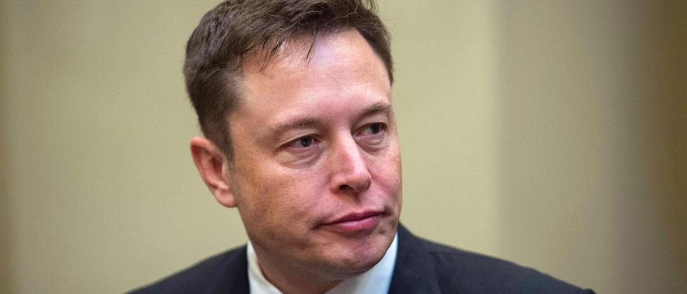 In this file photo taken on January 23, 2017 SpaceX CEO Elon Musk listens to US President Donald Trump speak during a meeting with business leaders in the Roosevelt Room at the White House in Washington, DC. Nicholas Kamm/AFP