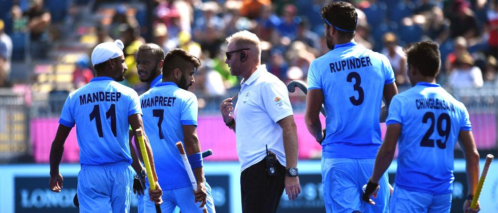 India's coach Sjoerd Marijne speaks to his team during the men's field hockey match between India and Malaysia at the 2018 Gold Coast Commonwealth Games on the Gold Coast on April 10, 2018. Anthony Wallace/AFP