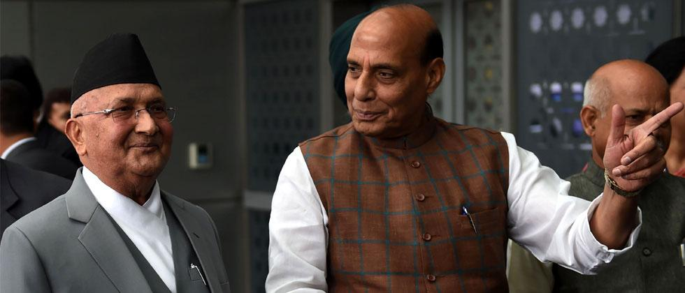 Nepali Prime Minister K.P. Sharma Oli walks with Indian Home Minister Rajnath Singh upon his arrival at the Indira Gandhi international airport in New Delhi on April 6, 2018. AFP Photo/Money Sharma