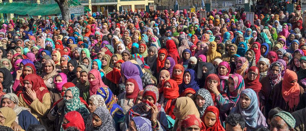Women wail during the funeral of civilians who were killed in a shootout at Pahoo in Shopian district of south Kashmir. Four youth and a militant were killed in the firing incident. PTI Photo