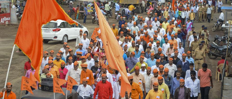 Protestors from the Maratha community take part in a rally demanding reservation, in Karad, Maharashtra on Tuesday. PTI Photo