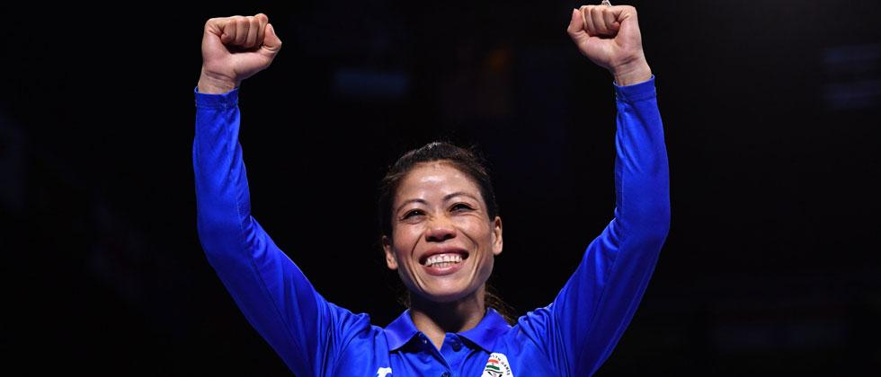 India's MC Mary Kom waits to receive her gold medal after beating Northern Ireland's Kristina O'Hara in their women's 45-48kg final boxing match during the 2018 Gold Coast Commonwealth Games. Anthony Wallace/AFP