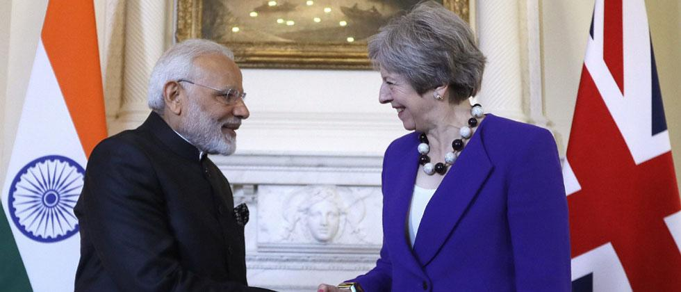 Britain's Prime Minister Theresa May shakes hands with Narendra Modi, the Prime Minister of India during a bilateral meeting at 10 Downing Street in London, Wednesday, April 18, 2018. AP/PTI