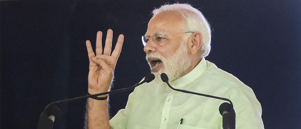 Prime Minister Narendra Modi addresses during the inauguration of 135km long Eastern Peripheral Expressway (NH-II) connecting Kundli to Palwal, at Bagpat, in Uttar Pradesh, on Sunday. Vijay Verma/PTI