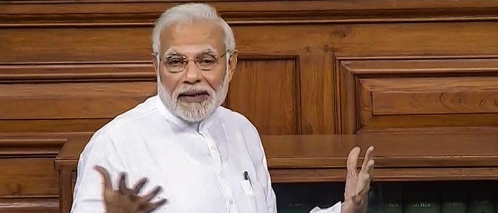 Prime Minister Narendra Modi speaks in the Lok Sabha on 'no-confidence motion' during the Monsoon Session of Parliament, in New Delhi on Friday, July 20, 2018. LSTV Grab via PTI