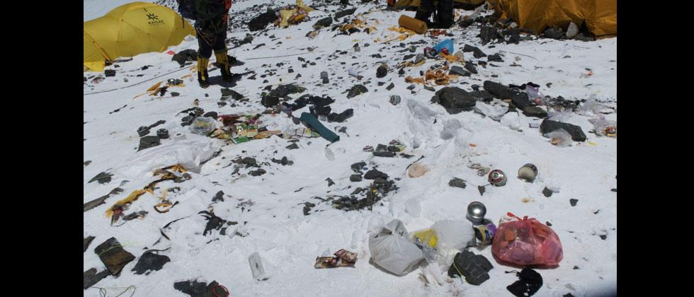 Handout picture taken on May 20, 2018 and released on June 12 by Damian Benegas shows discarded climbing equipment and rubbish scattered around Camp 4 of Mount Everest. Damian Benegas/AFP