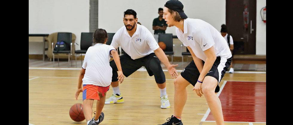 Kelly Olynyk (right) and Satnam Singh during the Jr NBA camp