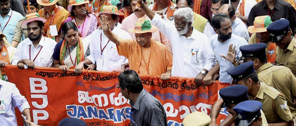 Uttar Pradesh CM Yogi Adityanath joins Kerala BJP President Kummanam Rajasekhara's Janaraksha Yathra in Kannur on Wednesday. PTI Photo