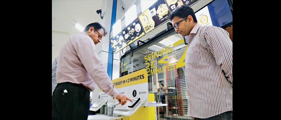The robot-assisted food dispensing machine and outlet for passengers that was installed at Pune airport is getting a good response. Vaibhav Thombare/Sakal Times