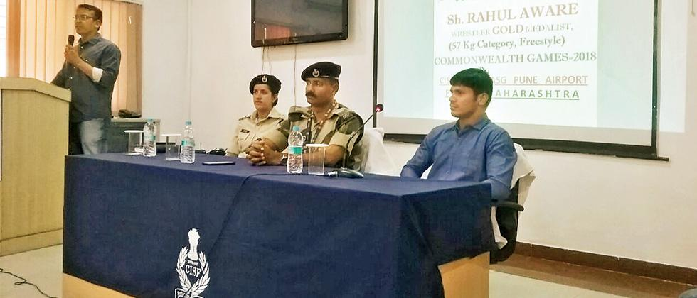 CISF personnel interact with CWG gold medalist Aware