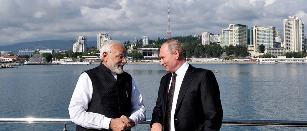 Narendra Modi with the Russian President Vladimir Putin, at Sochi, Russia on Monday. PTI Photo/PIB