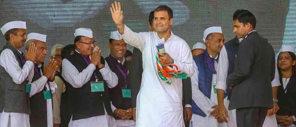 Woman Congress worker kisses Rahul Gandhi on stage in Gujarat