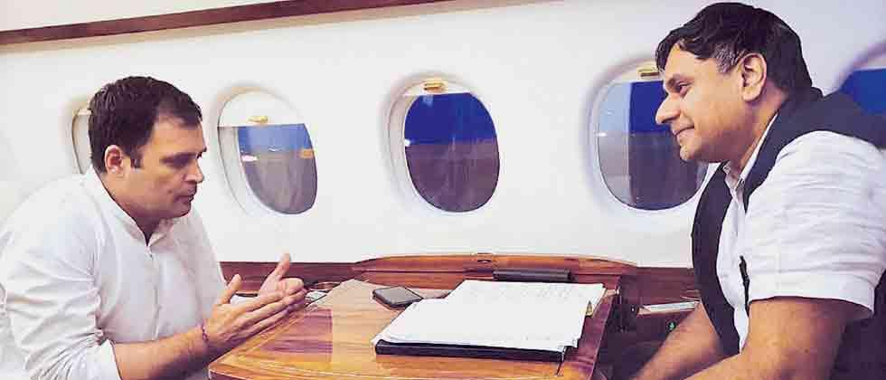 Talking about issues: Congress National President Rahul Gandhi (L) during an exclusive interview with Sakal Media Group's Managing Director Abhijit Pawar, on a flight from Diu to Nanded.