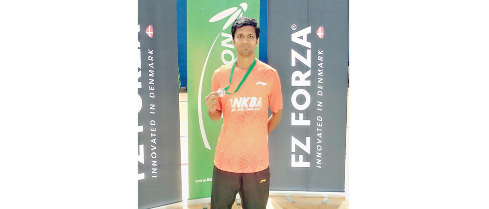 Sukant Kadam shows off his bronze medal won at the Irish Para-Badminton.