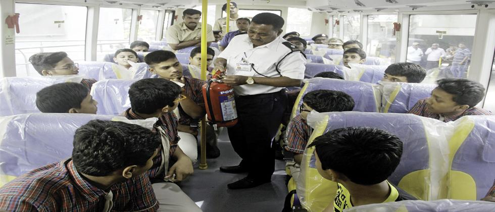 A firefighter demonstrates the use of a fire extinguisher to students in a school bus during a workshop organised by Pune RTO at Pandit Bhimsen Joshi auditorium in Aundh on Saturday.