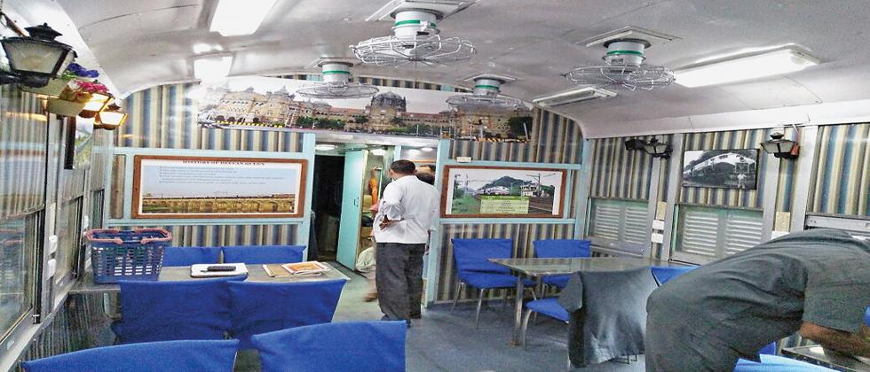 A inside view of modified dining car with modern facilities and attractive interiors.