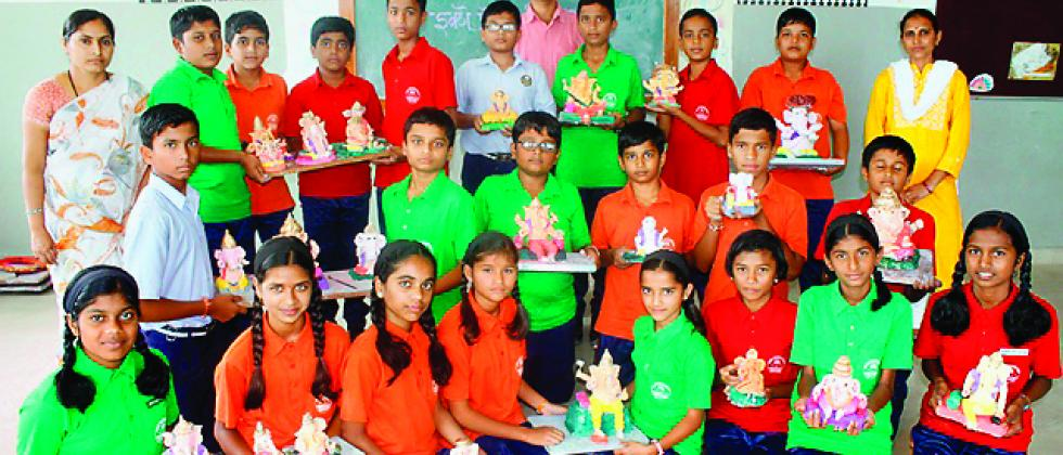 Students of Vidya Pratishthan's Someshwar English Medium School (VPSEMS) with their eco-friendly Ganesh idols