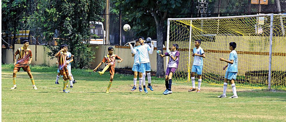 Players of Hutchings (in blue) in action against Bishop's.