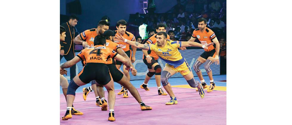 Raider and captain Ajay Thakur of Tamil Thalaivas in action during their PKL Season 5 match against U Mumba at Sawai Mansingh Stadium on Tuesday.