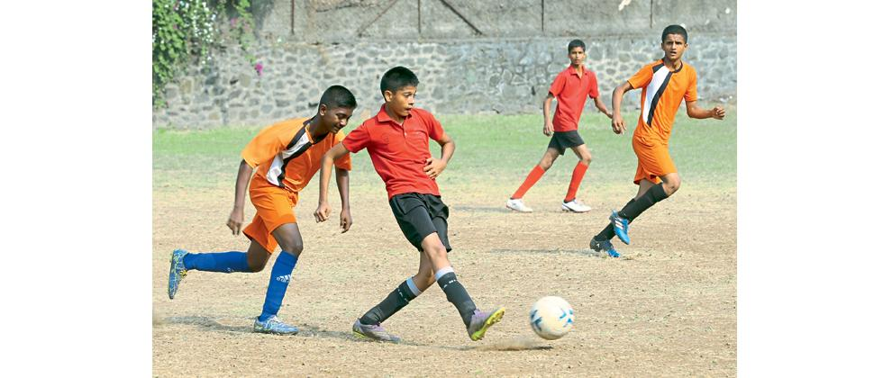 A player from Dr (Mrs) Erin N. Nagarvala School (in red) vies for the ball during their match against Stella Maris English School in the The Late Principal ND Nagarvala Football tournament at Nagarvala Football ground on Friday.