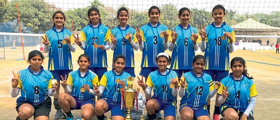 Millennium National School girls team pose for picture after winnning gold medal in the Under-17 National Volleyball tournament held in Delhi.