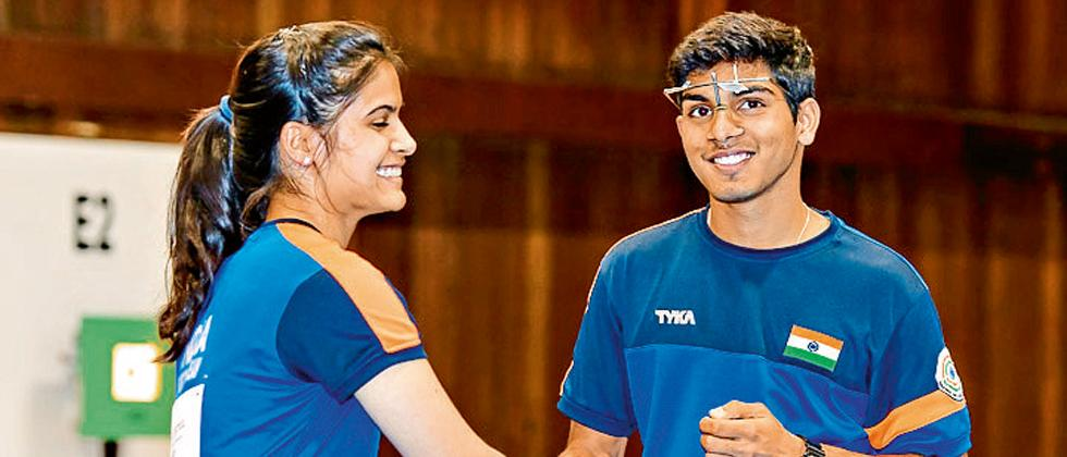 Gold medalist Team of Indian pistol shooters Manu Bhaker (left) and Anmol Jain celebrate their medal win in the 10m Air Pistol Mixed Team final in the ISSF Junior World Cup at the Sydney International Shooting Centre on Tuesday.