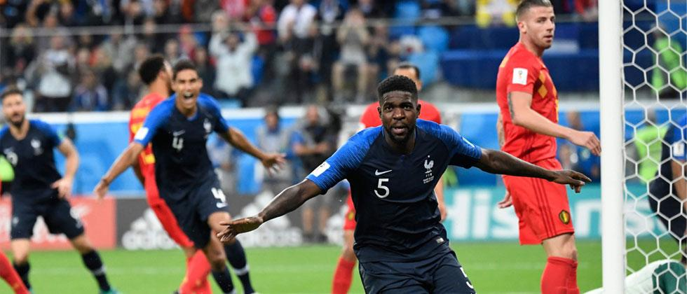 France's defender Samuel Umtiti celebrates scoring the opening goal during the Russia 2018 World Cup semi-final football match between France and Belgium at the Saint Petersburg Stadium in Saint Petersburg on July 10, 2018. Christophe Simon/AFP