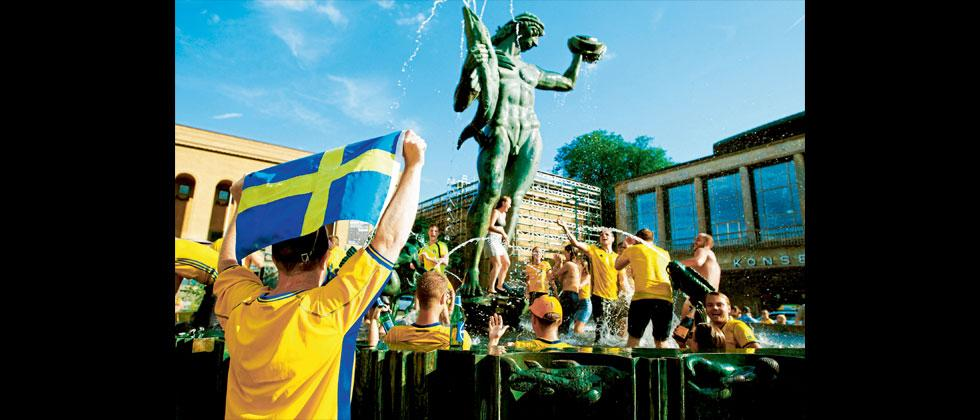 Swedish fans celebrate in central Gothenburg, Sweden, as Sweden beat Mexico to reach knockout stage