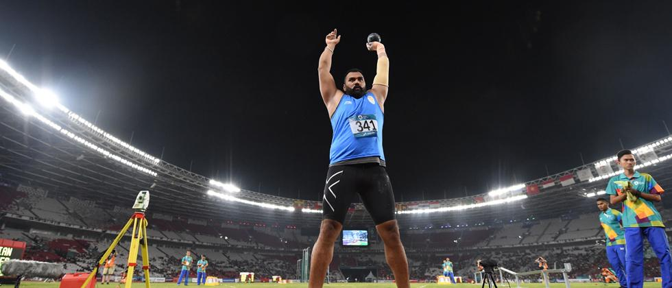 Tejinderpal clinches gold in shot put with record throw