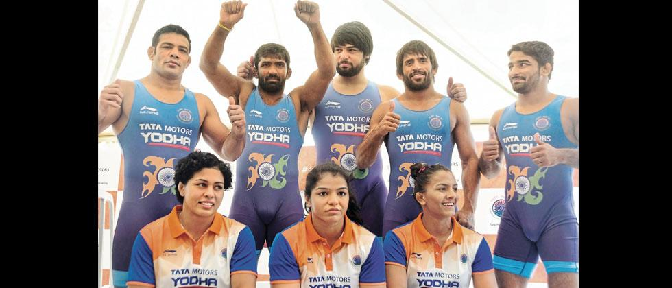 Wrestlers (from left-top) Sushil Kumar, Yogeshwar Dutt, Bajarang Punia, Sandeep Tomer, Satyawart Kadian, (from right) Geeta Phogat, Sakshi Malik and Pooja Dhanda during the official Tata Yodha jersey unvieling ceremony.  Prashant Sawant/Sakal Times