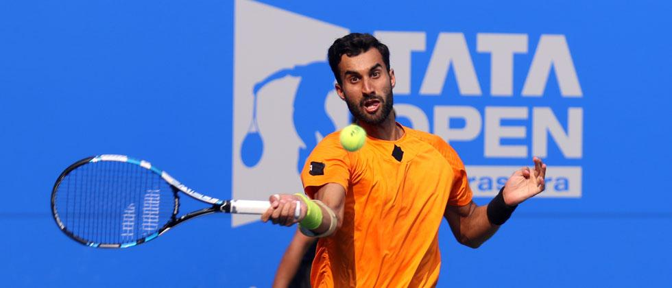 India's Yuki Bhambri and France's Pierre-Hugues Herbert in action during their second round match of the Tata Open Maharashtra at the Mhalunge Balewadi Stadium in Pune