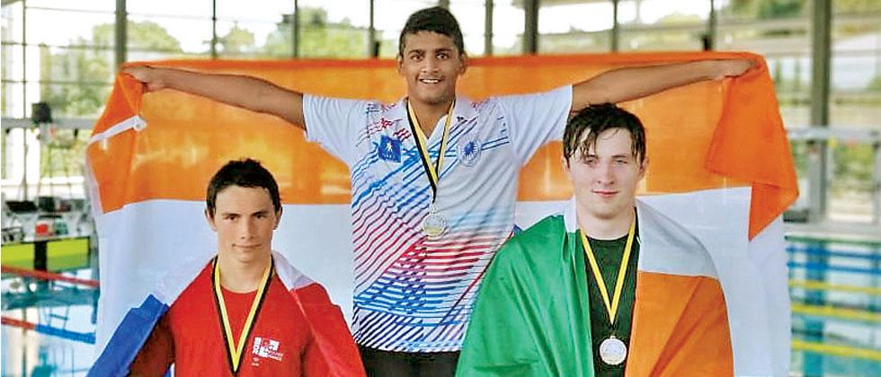 Siddhant Khopade poses on the podium