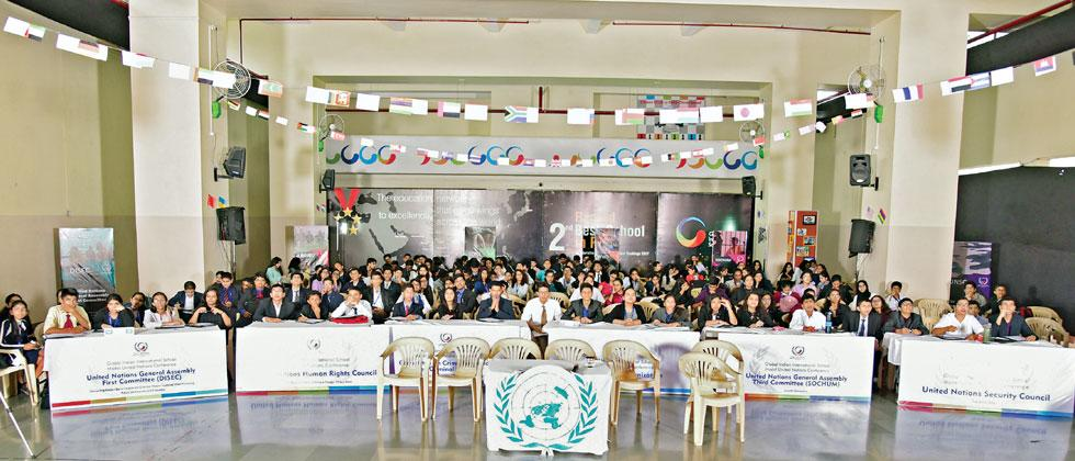 Participants pose for a photo during the Model United Nations (MUN) Conference hosted by Global Indian International School (GIIS), Chinchwad recently