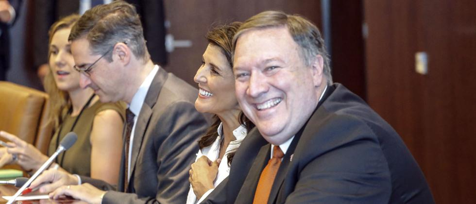 U S Secretary of State Mike Pompeo sits next to US Ambassador to the UN Nikki Haley while he visits UN Secretary-General Antonio Guterres office at the U N headquarters on Friday in New York City.