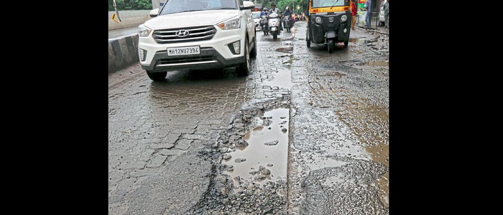 The road near Swargate Chowk has many potholes. Anand Chaini/Sakal Times