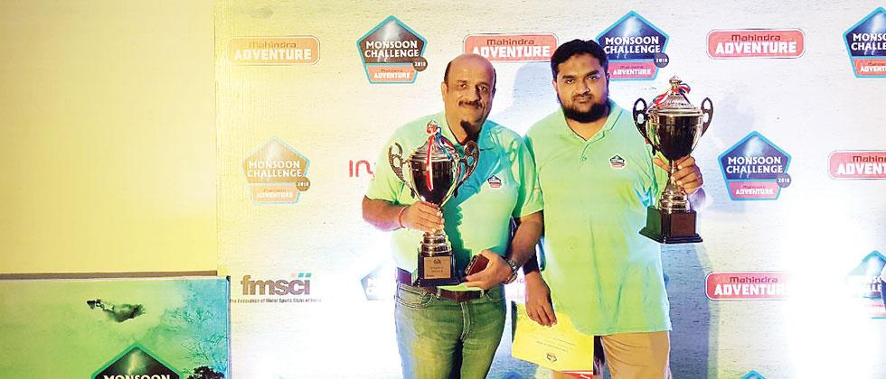 International rally driver SanjayTakale and Mohamad Mustafa with their 2018 winners' trophies in Goa