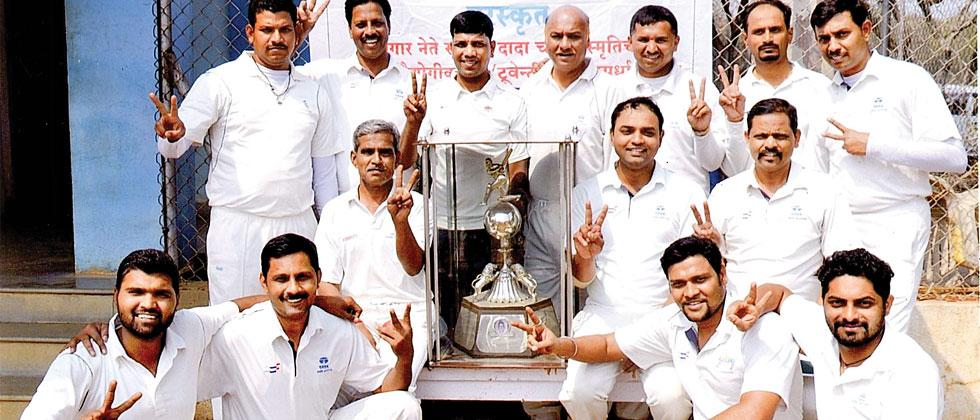 Players of Tata Motors pose with their trophy after defeating Soft Hard at the Tata Motors ground