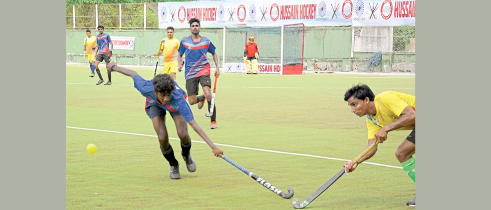 Match in progress between SRPF and Chikalwadi Young Boys (CYB) at Major Dhyan Chand Hockey Stadium.