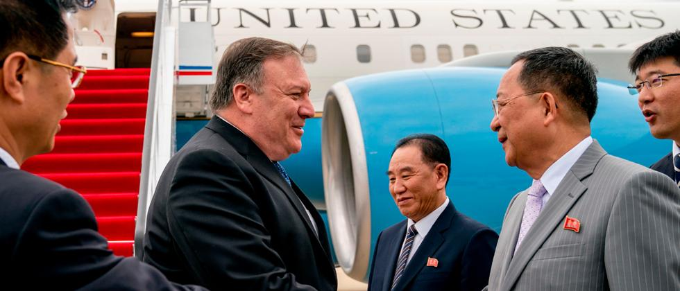US Secretary of State Mike Pompeo (2nd L) is greeted by North Korean director of the United Front Department, Kim Yong Chol (C) and North Korea's Foreign Minister Ri Yong Ho (2nd R) as he arrives at Sunan International Airport in Pyongyang on Friday.