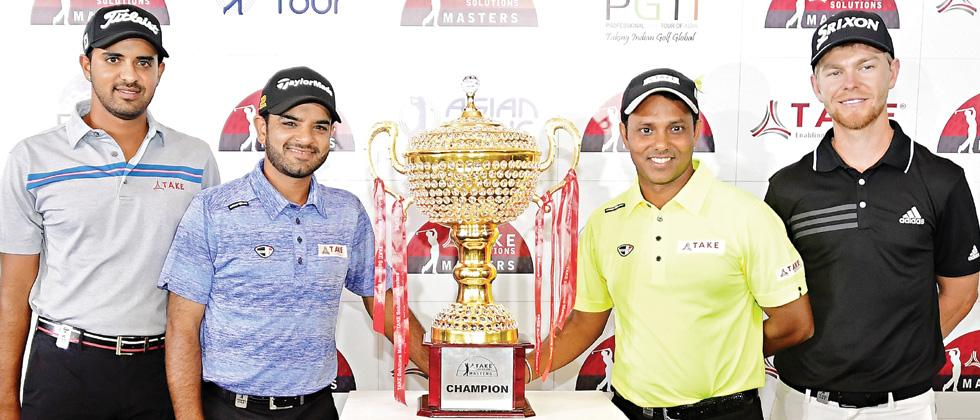 (from left) Golfers Khalin Joshi, Chiragh Kumar and SSP Chawrasia with the TAKE Solutions Masters trophy at the Karnataka Golf Association on Wednesday.