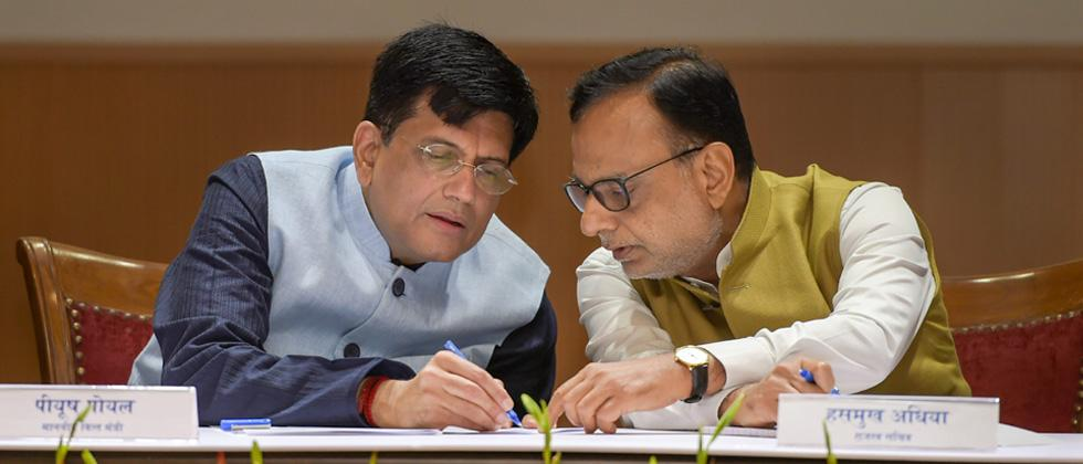 Finance Minister Piyush Goyal and Finance Secretary Hasmukh Adhia (R) during the 'GST Day' celebration on completing one year, at Ambedkar International Centre in New Delhi on Sunday.