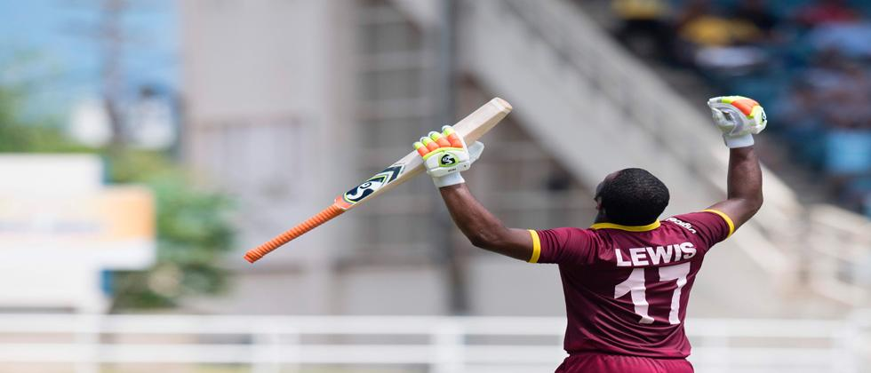 West Indies' Evin Lewis celebrates scoring a century during the T20 match between West Indies and India at the Sabina Park Cricket Ground in Kingston, Jamaica, on July 9, 2017. / AFP PHOTO