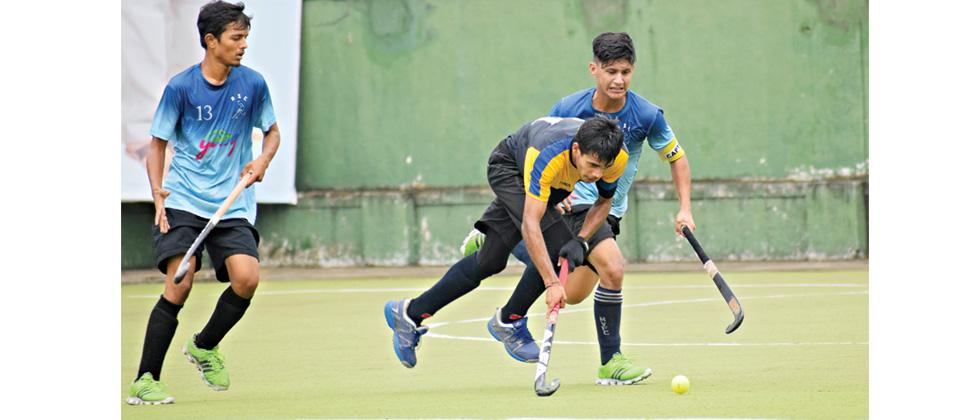 A player from Krida Prabodhini, Balewadi hits the ball during their match against Mumbai Republicans at Major Dhyan Chand Hockey Stadium, Nehrunagar in Pimpri.